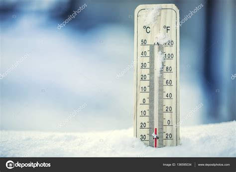is 20 degrees fahrenheit cold thermometer on snow shows low temperatures under zero low
