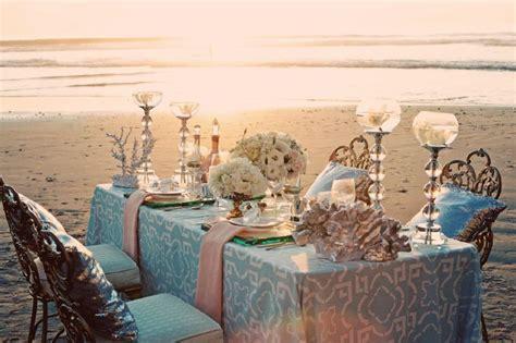blue wedding reception table setting on the beach