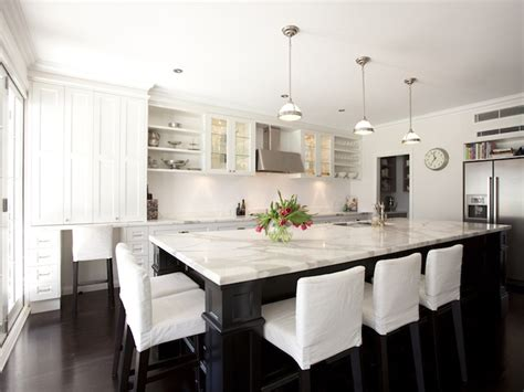 white kitchen island with seating slipcovered counter stools transitional kitchen