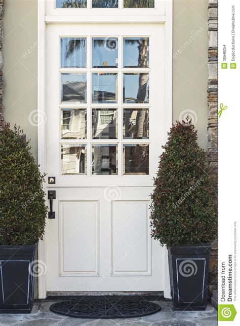 White Front Doors White Front Door To Modern Home Flanked By Plants Stock Photo Image 38940254