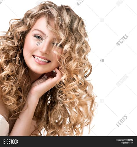 perm for big face beauty girl blonde curly hair image photo bigstock