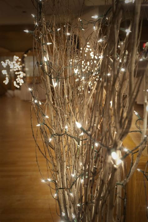 sparkly lights in branches   attach to poles and as