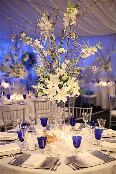 Cylinder Vases With Floating Candles And Flowers Photo