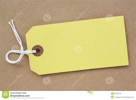 How To Make Paper Tags - yellow paper luggage tag stock photo image 30102540