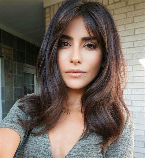 above shoulder tapered around face hairstyle hair balayage warm brunette long bangs fringe face framing
