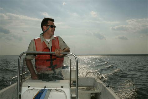boat driving man free picture men driving boat boat patrol