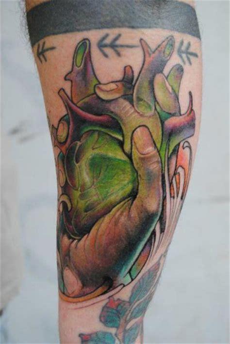 tattoo new school hand arm fantasy new school heart hand tattoo by victor chil