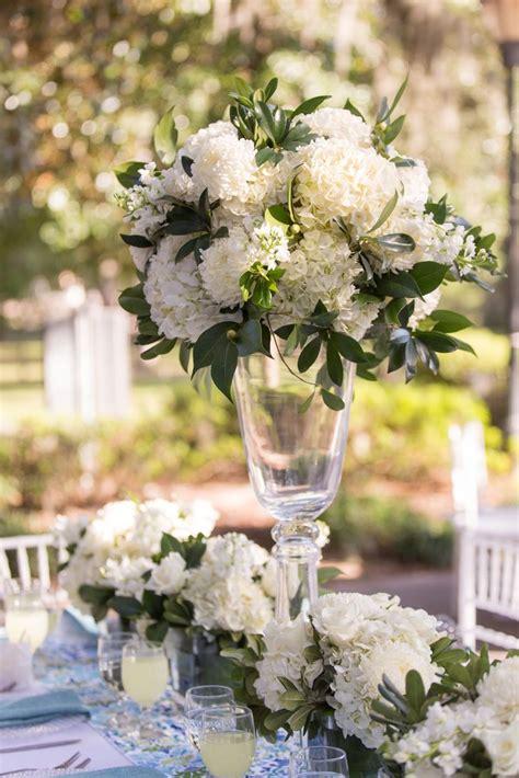 tall glass centerpieces with lush hydrangea arrangements