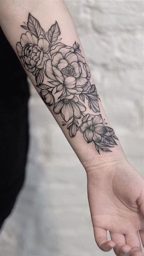 tattoo flower forearm the shading and cluster size and outline is perfect love