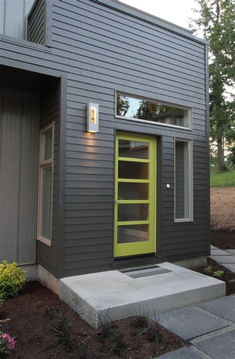 modern front door with exterior floors exterior