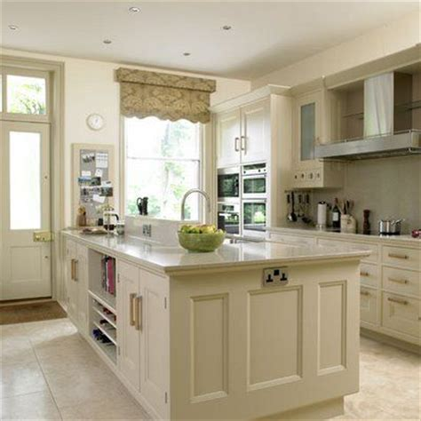 Linen Kitchen Cabinets Beige Linen Colored Kitchen Cabinets With Slightly Darker Counters And Stainless Appliances