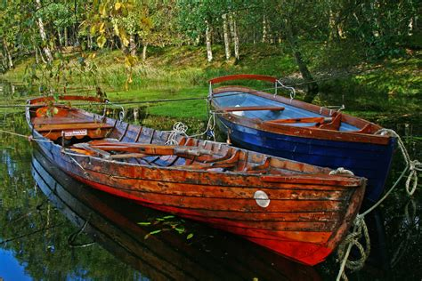 row boat on water derwent water row boats lake district these row boats