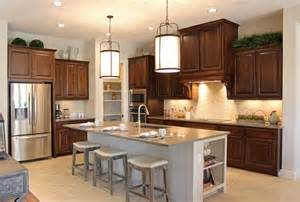 Kitchens With Different Colored Islands burrows cabinets kitchen in knotty alder w custom vent hood