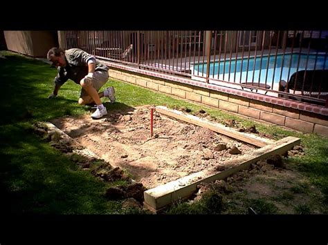 preparing the backyard horseshoe pits for some summer