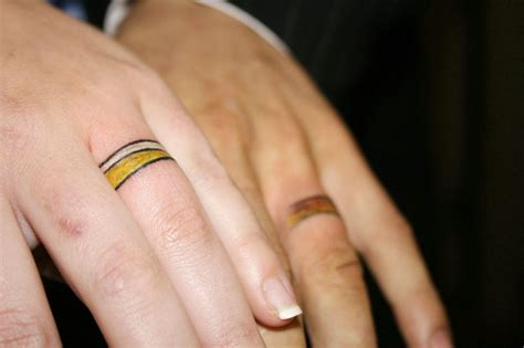 wedding tattoos on fingers colored wedding ring finger tattoos