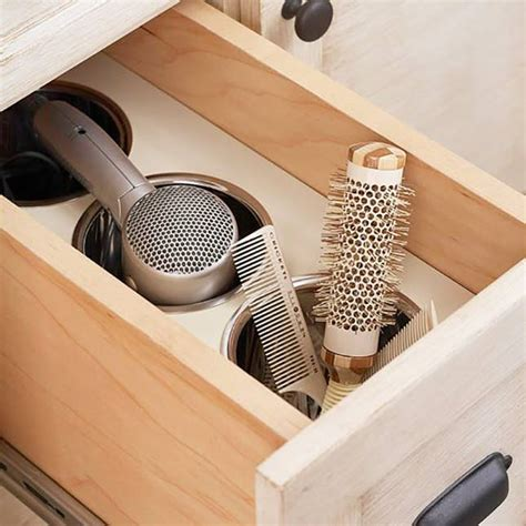 Hair Dryer Drawer Insert by Roll Out 17 Ways To Organize Drawers Brit Co