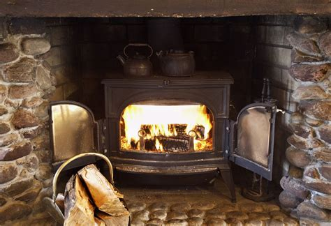 in a burning room meaning wood heat vs pellet stove differences