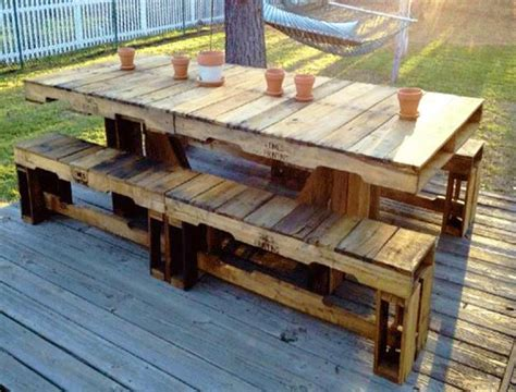 Outdoor seating area with chairs and coffee table made of salvaged