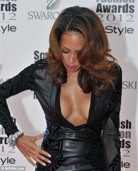 Jade Ewen almost reveals too much cleavage in very low cut leather dress at Scottish Fashion