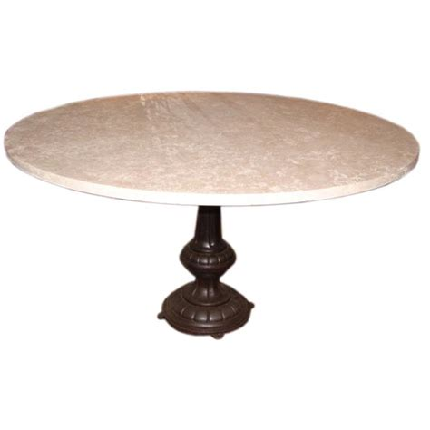 travertine top dining table w cast iron pedestal at