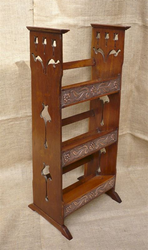 arts and crafts bookcase in oak with copper panels