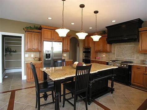 oak cabinets  black island  stove tile floors