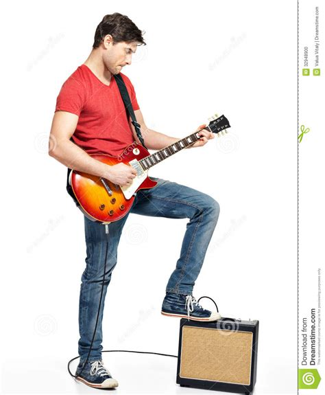 who is the guy that plays guitar and sings on the new direct tv commercials guitarist man plays on the electric guitar stock photo
