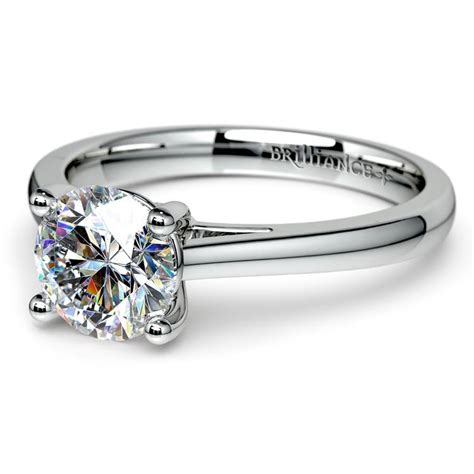 cathedral solitaire engagement ring in platinum