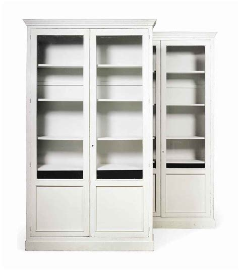 a pair of white painted bookcases mid 20th century