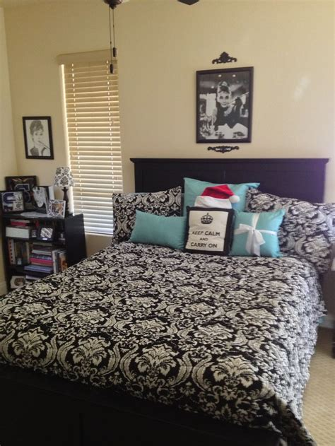 tiffany blue and black bedroom queen bed damask comforter with tiffany blue pillows audrey hepburn poster above bed with