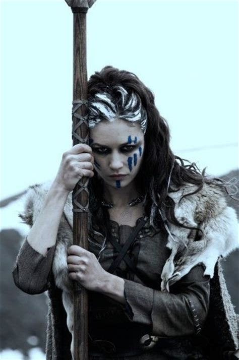 female warrior hair warrior woman with blue woad face paint and lye in her
