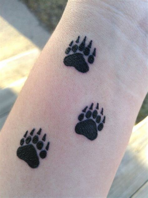 bear print tattoo 1000 ideas about paw tattoos on black