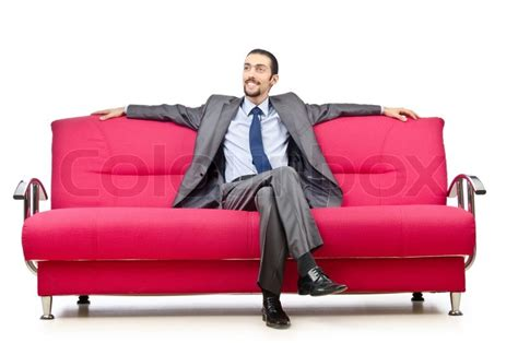 sitting in sofa man sitting in the sofa stock photo colourbox