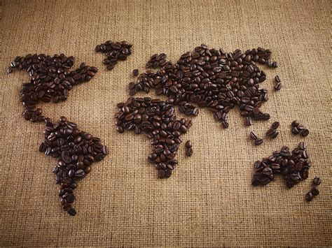 coffee map wallpaper coffee beans forming world map on burlap photograph by