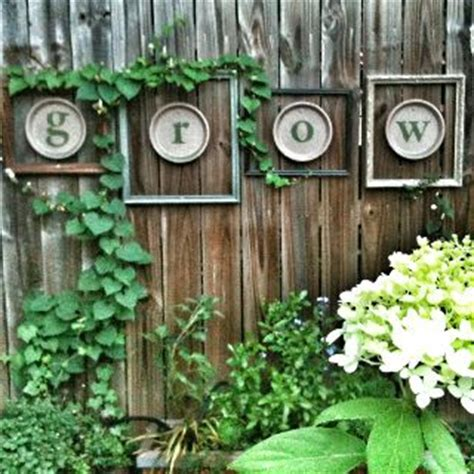 Garden Fence Decor What A Creative Idea For Your Garden Fence Home Made Spray Painted Ceramic Dishes Miss