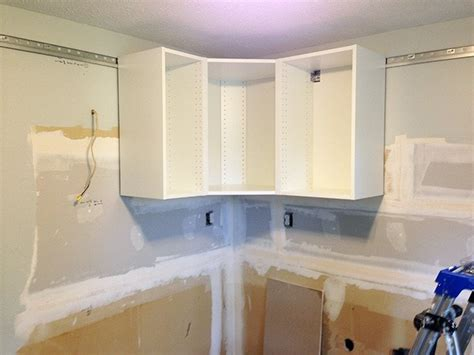 how to hang kitchen wall cabinets how to design and install ikea sektion kitchen cabinets abby lawson