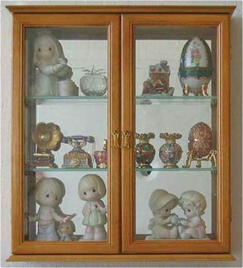 wall mounted curio cabinet wall mounted curio cabinet with glass doors to reveal the