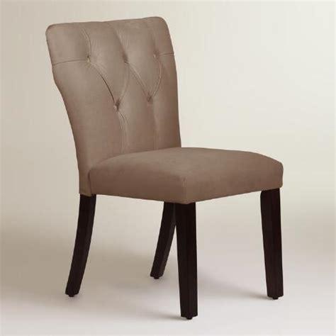 world upholstered dining chairs velvet tufted gabie upholstered dining chair world market