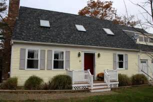 curb appeal harrisonburg soft yellow exterior with grey shutters house colors