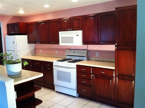 staining kitchen cabinets before and after kitchen cabinet refinishing painting staining greater