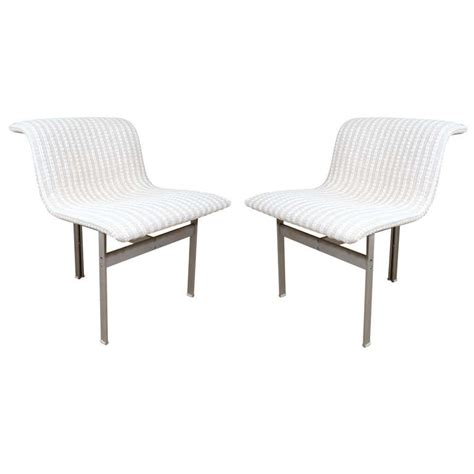 stainless steel undulating dining chairs by saporiti at