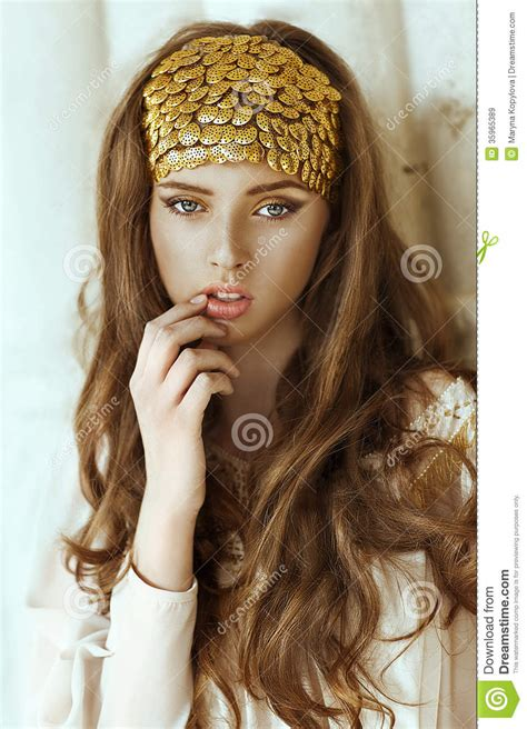 girl with brown hair and gold eyes young beautiful girl with long hair and gold fashion crown