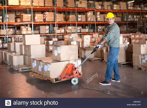 warehouse worker operating pallet stock photo