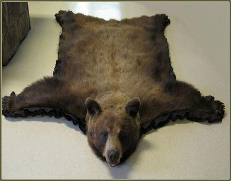 on a bearskin rug best 25 skin rug ideas on langley news viking decor and shabby chic rugs uk