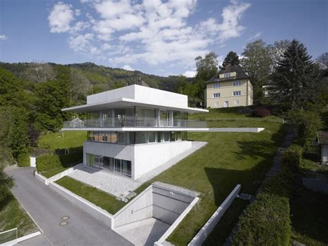 homes built into hillside partially cut into the hillside house by the lake in