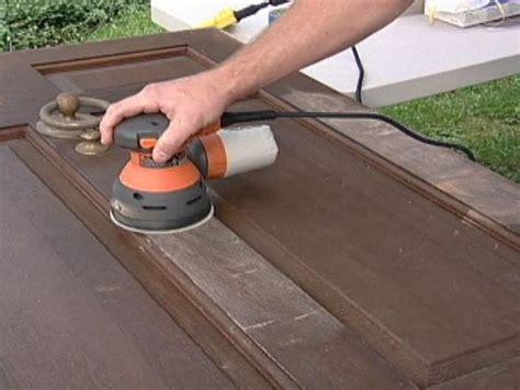 sanding woodwork how to refinish a solid wood door how tos diy