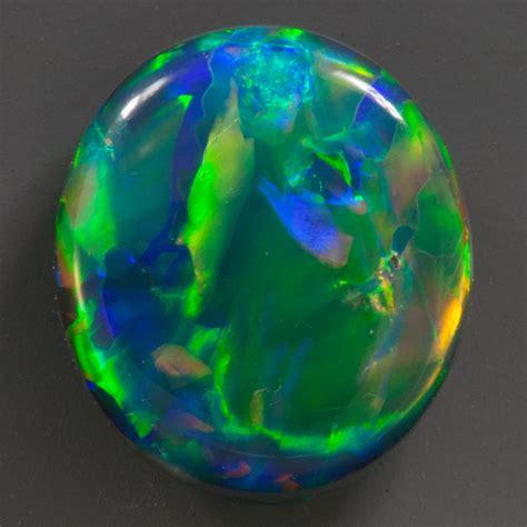 Black Opal 10 2 44 carat black opal oval 10 3x9 mm australia