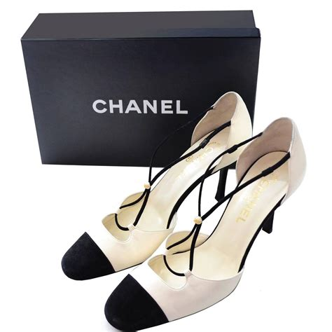 Fashion Shoes By Chanel chanel ivory leather black suede cross heels shoes in box 39 5 cap toe for sale at 1stdibs
