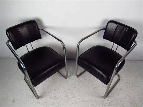 set of four italian black leather and chrome chairs for