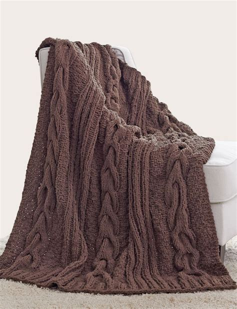 cozy wool appliquã 11 seasonal folk projects for your home books yarnspirations bernat horseshoe cable blanket